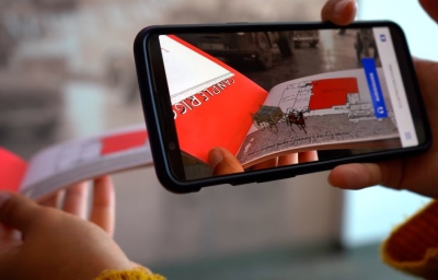 image of hands holding a mobile phone with SENSEcity's augmented reality app