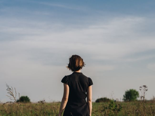 Woman from behind looking at view