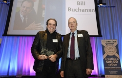 Professor Bill Buchanan receiving award from Professor Donald MacRae at the Scottish Knowledge Exchange Awards