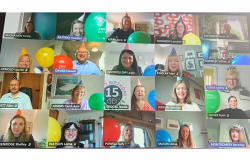 Video call sceenshot of 20 people with hats and balloons