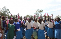 A group of girls holding Flowco sanitary products